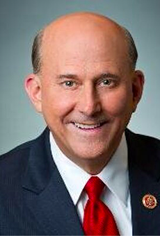 U.S. Rep. Louie Gohmert reportedly posed with a QAnon-promoting podcaster who has claimed he participated in the January 6 insurrection.