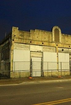 The Whitt building as it stands facing West Houston Street on the night of May 30.