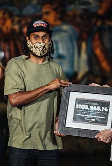 Spurs guard Patty Mills presents a $104,000 donation to Family Violence Prevention Services last year as part of a fundraiser he organized.