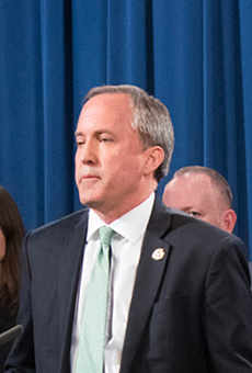 Texas Attorney General Ken Paxton steps up to the podium during an event.