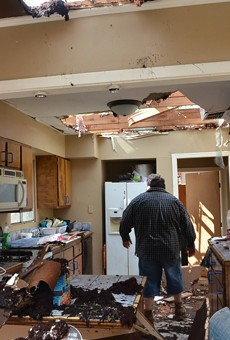 Adrian Venegas stands in what's left of his kitchen.