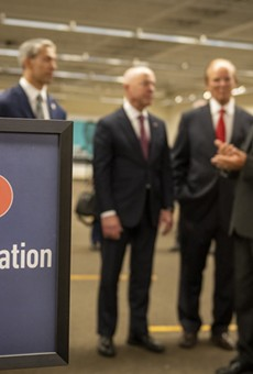 Homeland Security Secretary Alejandro Mayorkas (second from left) tours the mass vaccination site at San Antonio's Wonderland of the Americas mall.