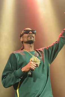 Snoop Dogg will post up at the Sunken Garden on Friday.