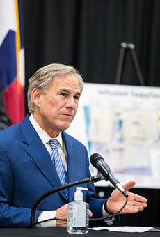 Gov. Greg Abbott makes his squinty face at a press event so people will know he's being tough.
