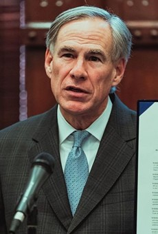 Order Up: Gov. Greg Abbott displays another executive order he signed last year.