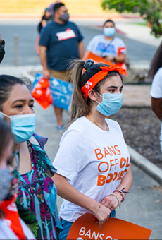 Protesters listen intently to a speaker at a San Antonio rally against the Texas abortion ban.