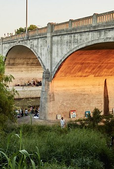 People gather under the Roosevelt Avenue Bridge on June 21 for a concert organized by the Echo Bridge Appreciation Society.