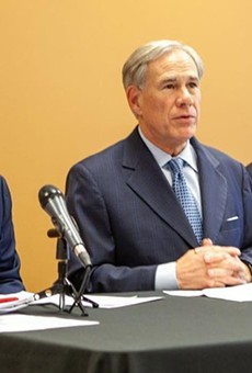 Gov. Greg Abbott (center) appears with State Rep. Briscoe Cain (left) and Sen. Paul Bettencourt, Republican lawmakers who pushed the state's restrictive new voting laws.