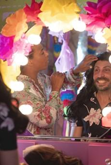Del Rio Mayor Bruno Lozano (right) tries on a wig in preparation for his drag performance.