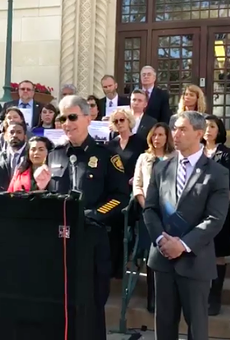 Chief McManus, flanked by San Antonio officials, at Thursday's press conference.