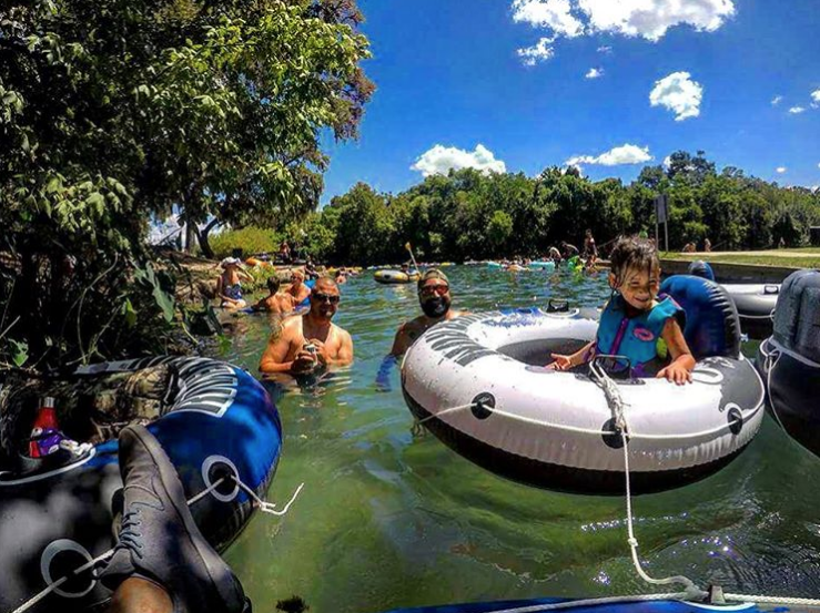 Tubers enjoy sun and suds on New Braunfels' Comal River. - INSTAGRAM / DERRRIKRAGE