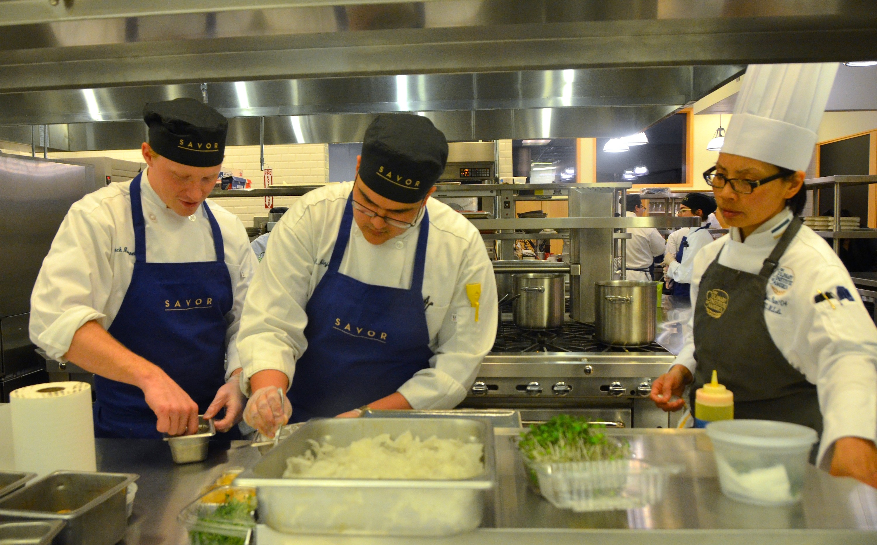 Click to enlarge cia students prepare dishes for guests at savor the restaurant will provide students with real