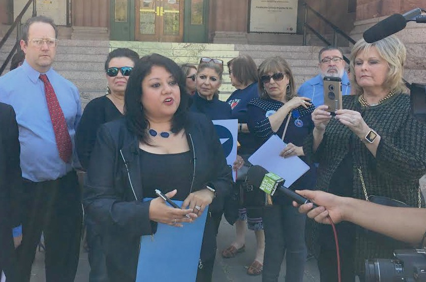 Bexar County Democratic Party Chairwoman Monica Alcantara speaks to the press outside the Bexar County Courthouse. - SANFORD NOWLIN
