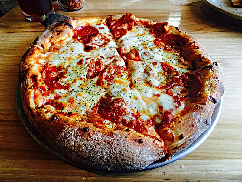 Testing Halftime Pizza's basic pie is a must. - ELI TARIN