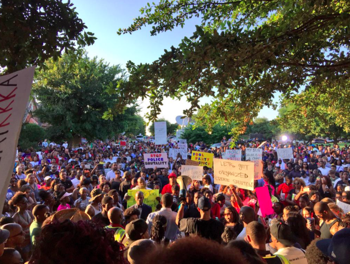 Hundreds demonstrated outside an elementary school in McKinney to protest. - VIA TWITTER USER @DERAY