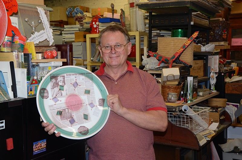 Gene Elder with one of his LGBT history plates. - BRYAN RINDFUSS