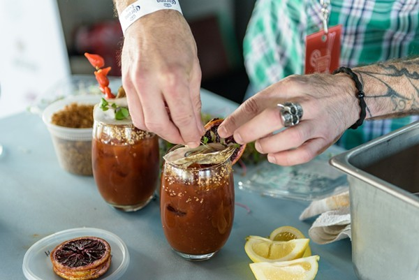 Chef Crumley prepares his competition-winning Bloody Mary, complete with oyster garnish, at United We Brunch 2020. - JAIME MONZON