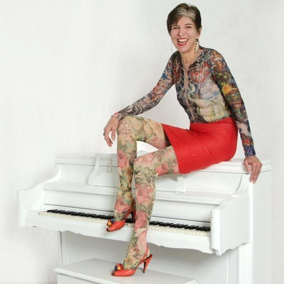 Piano player Marcia Ball repping her faux-tat sleeves - COURTESY