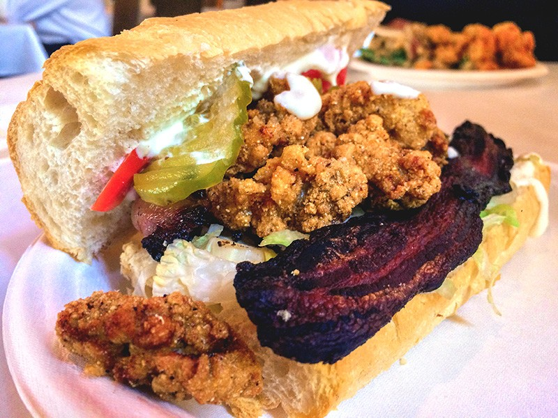 The Peacemaker po'boy with fried oysters and house-made bacon at The Cookhouse. - JESSICA ELIZARRARAS
