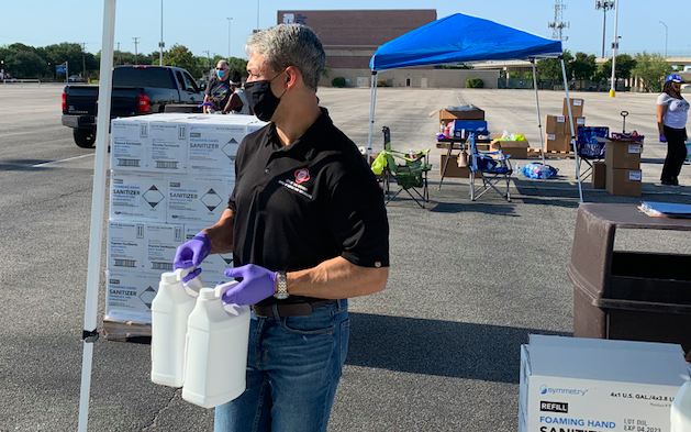 Mayor Ron Nirenberg helps hand out sanitizer to small businesses during an event this summer. - TWITTER / @RON_NIRENBERG