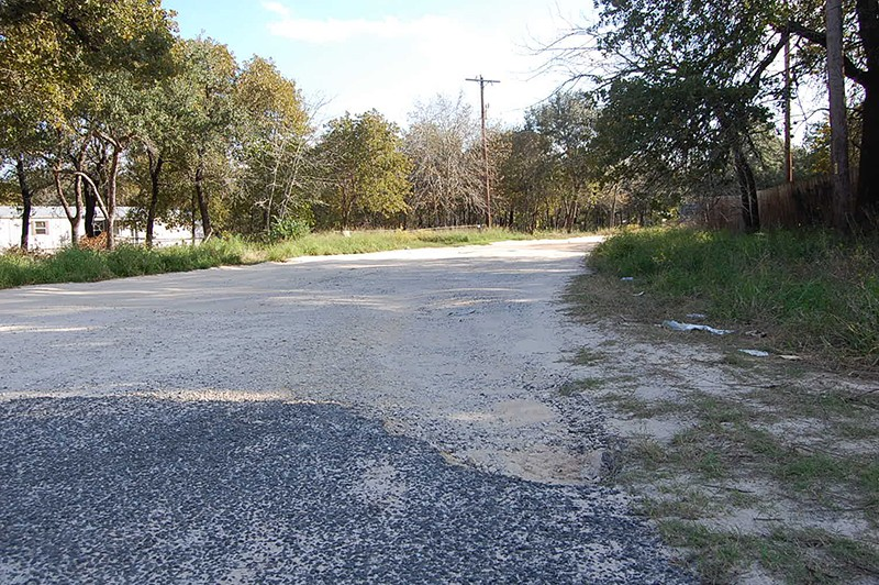 The few stretches of pavement in Highland Oaks quickly give way to sand. - MICHAEL MARKS
