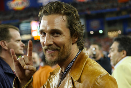 Matthew McConaughey flashes the hook 'em horns sign at a UT football game. - INSTAGRAM / WDPG SHARE