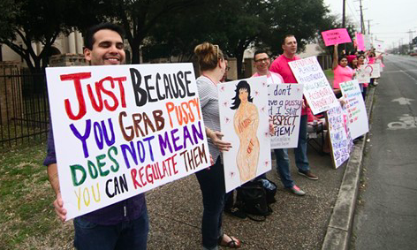 Planned Parenthood supporters hold signs at a San Antonio rally in 2017. - MICHAEL BARAJAS