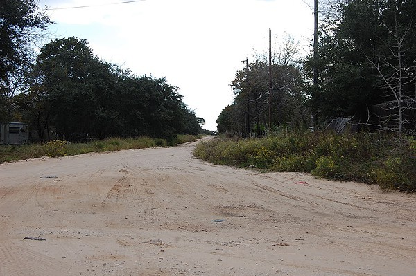 The Bexar County Commissioners Court will look into paving roads like this one. - MICHAEL MARKS