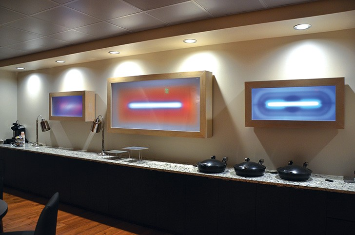 Light installations by Cathy Cunningham-Little glow in a Spurs suite.