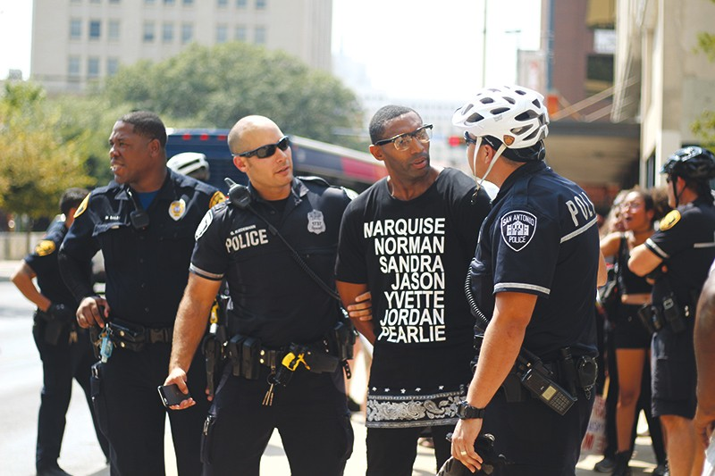 Black Lives Matter organizer Mike Lowe is shown being arrested last summer in the file photo. Mayor Ivy Taylor has invited him to join a task force on police accountability reform. Lowe criticized a collective-bargaining agreement passed by City Council Thursday for not including accountability reform. - DARCELL DESIGNS