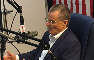 ERCOT CEO Bill Magness speaks about the power grid during an appearance at radio station KURV. - TWITTER / @ERCOT_ISO