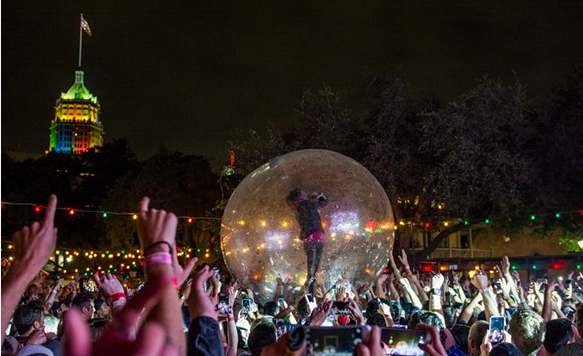 The Flaming Lips' Wayne Coyne belts it out from inside a plastic bubble during the band's 2016 performance at the Maverick Music Festival. - JAIME MONZON