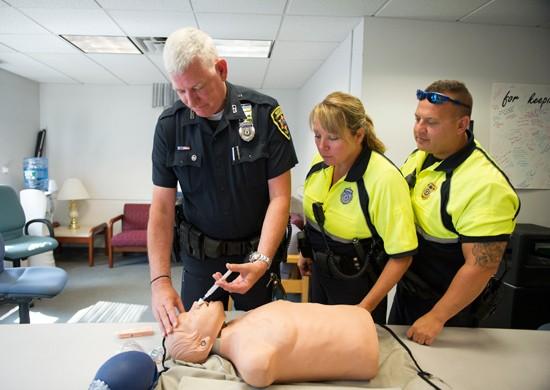 An Boston University police officer demonstrates how to administer naloxone. - BOSTON UNIVERSITY