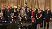 Gov. Greg Abbott signs open-carry bill in San Antonio and the pro-gun crowd shouts down a reporter