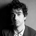 <i>Hereditary</i> Star Alex Wolff Gave His All in His Directorial Debut, and He's Got the Tattoos To Prove It