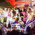 Light Up Your Saturday Night with the Illuminated Fiesta Flambeau Parade