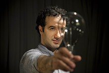 24390cb6_jad_abumrad-with_light_bulb_credit_marco_antonio_3.jpg