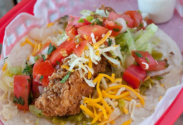 Torchy's Trailer Park taco with fried chicken, green chilies, lettuce, cheese, pico, poblano ranch - COURTESY