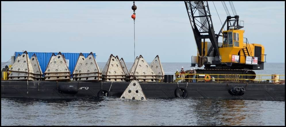 Workers lower concrete structures into the Gulf of Mexico. This will create an artificial reef. - TEXAS PARKS AND WILDLIFE DEPARTMENT