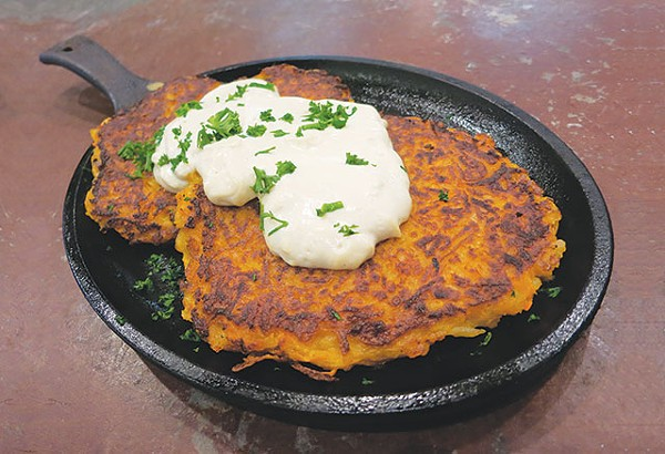 You can make traditional latkes at home or enjoy a sweet potato version from Green Vegetarian Restaurant (above) - MIRIAM SITZ