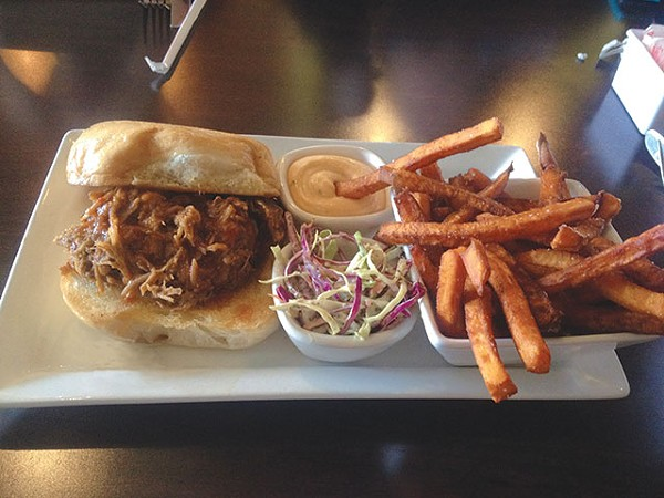 You'll want extra napkins for the juicy pulled pork sandwich - LAUREN W. MADRID