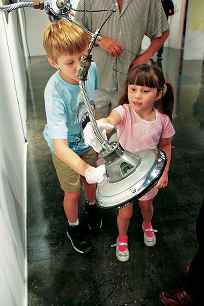 Young visitors play at 'Interplay: Mechanical Objects.' - COURTESY PHOTO