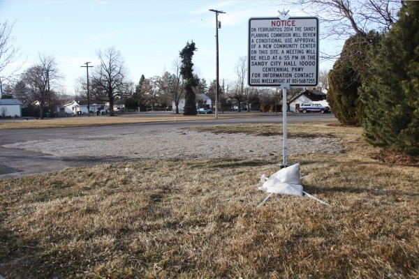 A sign at the proposed site of the Sandy Club advertises the Feb. 20 planning meeting - SARAH ARNOFF