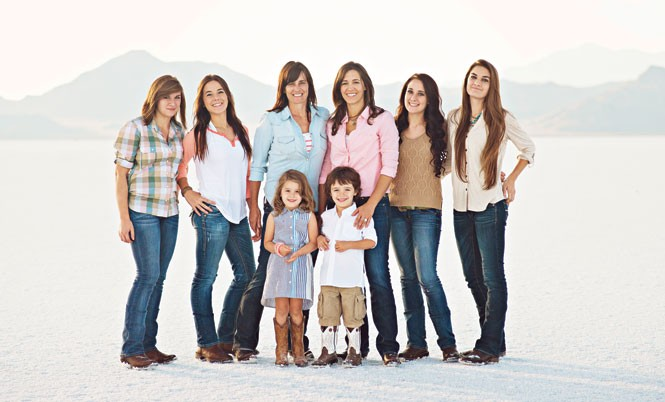 Allison Carr, in blue shirt, with her wife and children - COURTESY ALLISON CARR