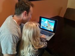 Dunn and his daughter playing Jaxi - ADAM DUNN