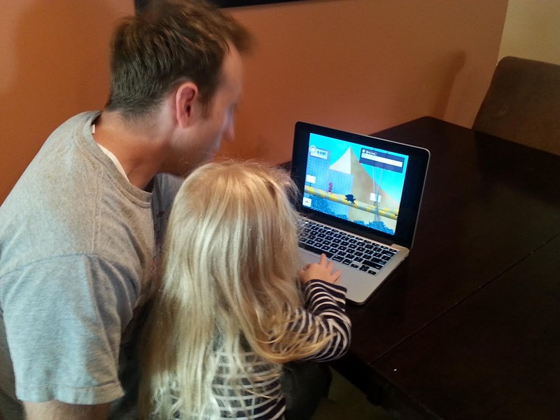 Dunn and his daughter playing Jaxi - ADAM DUNN