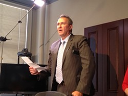Former Attorney General Mark Shurtleff reading a statement at a press conference in response to his July 15 arrest for 10 felony corruption charges