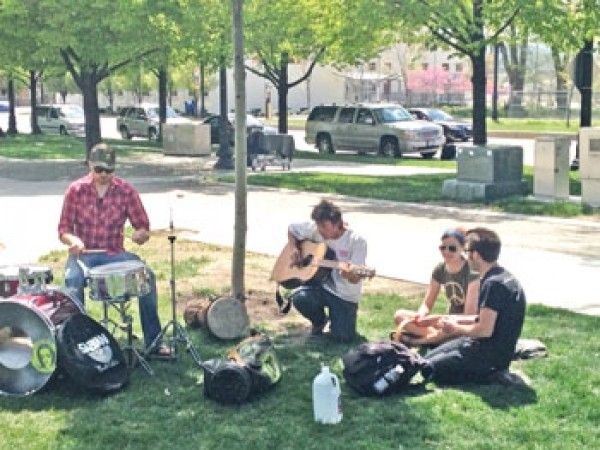 Jeff Williams plays guitar with Beneficial Humanism Movement
