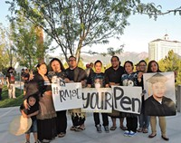 Raise Your Pen Coalition members at a vigil at the federal courthouse