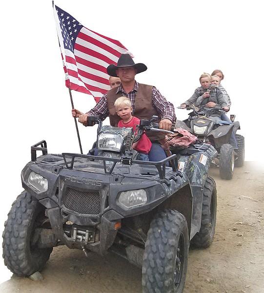 Ryan Bundy, son of Nevada rancher Cliven Bundy, rides his ATV through Recapture Canyon - ERIC TRENBEATH